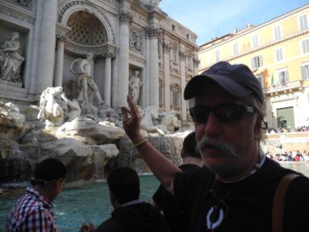 Throwing a coin into the Trevi Fountain