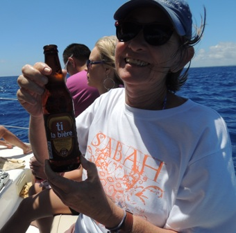 "The local beer. Here we are on a catamaran trip and Mary Ann took advantage of the ""all-inclusive"" thing."