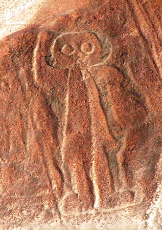If you are skeptical about what I said, then explain to me why the ancients would carve what is obviously an astronaut, in a helmet, wearing a life support system, and waving hello. (This photo taken from alaudan.blogspot.com, which does a great job of explaining the Nasca lines