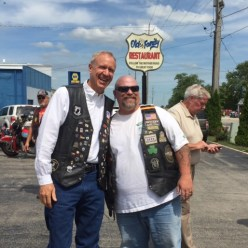 Governor Bruce Rauner poses for pictures during the Governor's motorcycle visit to Dwight Saturday, a stop on a charity ride to honor veterans.