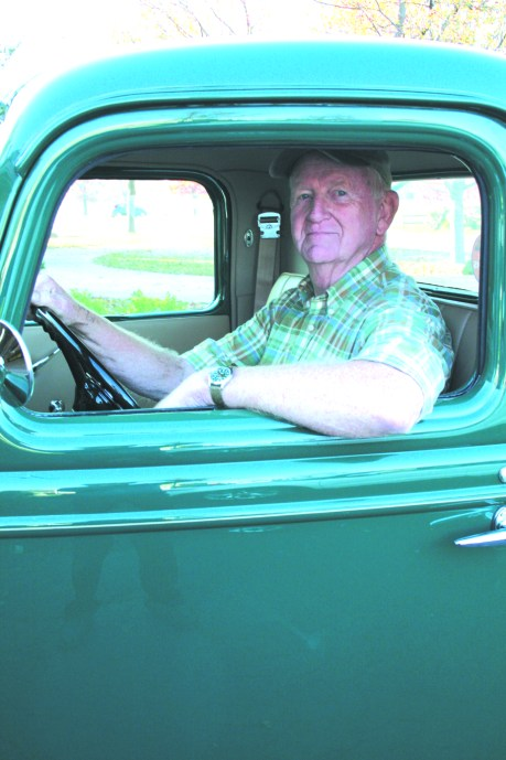 """JOHN GARDNER of Dwight sits in his """"new"""" vehicle, a refurbished 1936 Ford Pickup truck."""