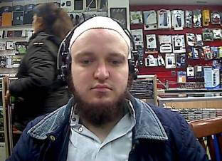 "Facebook picture of Craig Wallace also known as Muhammad Mujahid Islam.  A white Muslim convert who trolled a Tory MP on Facebook saying he would ""show her what it's like to murder innocents, you dirty pig f*****g whore"" was jailed today.  See NATIONAL story NNTROLL.  In the days after the Syrian airstrike vote in the Commons, Craig Wallace also known as Muhammad Mujahid Islam, targeted Charlotte Leslie.  Wallace, 23, who converted to Islam while in prison serving more than four years for attempted robbery, posted the threatening messages to the MP for Bristol North West just three weeks after being released.  He wrote on an existing thread on The UK Truth Movement Facebook page on Thursday December 3: ""I'm going to smash her windows and drop a bomb on her house when she is tucked up in bed, you dirty f*****g pig shagging slut.  By the way love you're f*****g hideous."""