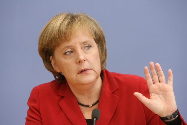 German Chancellor Angela Merkel gestures during a new year press conference in Berlin 15 January 2008. German Chancellor Angela Merkel voiced strong backing for the European Central Bank (ECB), rejecting a French call for a meeting of political leaders to mull monetary matters. Merkel also defended her China policy amid a major rift brought on by her meeting last year with the Dalai Lama, whom Beijing brands a dangerous separatist.  AFP PHOTO JOHN MACDOUGALL GERMANY-POLITICS-MERKEL