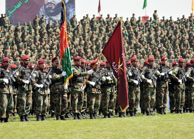 Members of the Afghan national army stand in formation as part of the Victory Day Parade at the Olympic Center in Kabul, Afghanistan, April 28. The parade is held every year in to commemorate the day when the Afghan mujahideen overthrew the socialist government in Afghanistan in 1992.