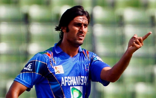 Afghanistan's Shapoor Zadran celebrates after taking the wicket of Sri Lanka's Lahiru Thirimanne during the Asia Cup one-day international cricket tournament in Dhaka, Bangladesh, Monday, March 3, 2014. (AP Photo/A.M. Ahad)