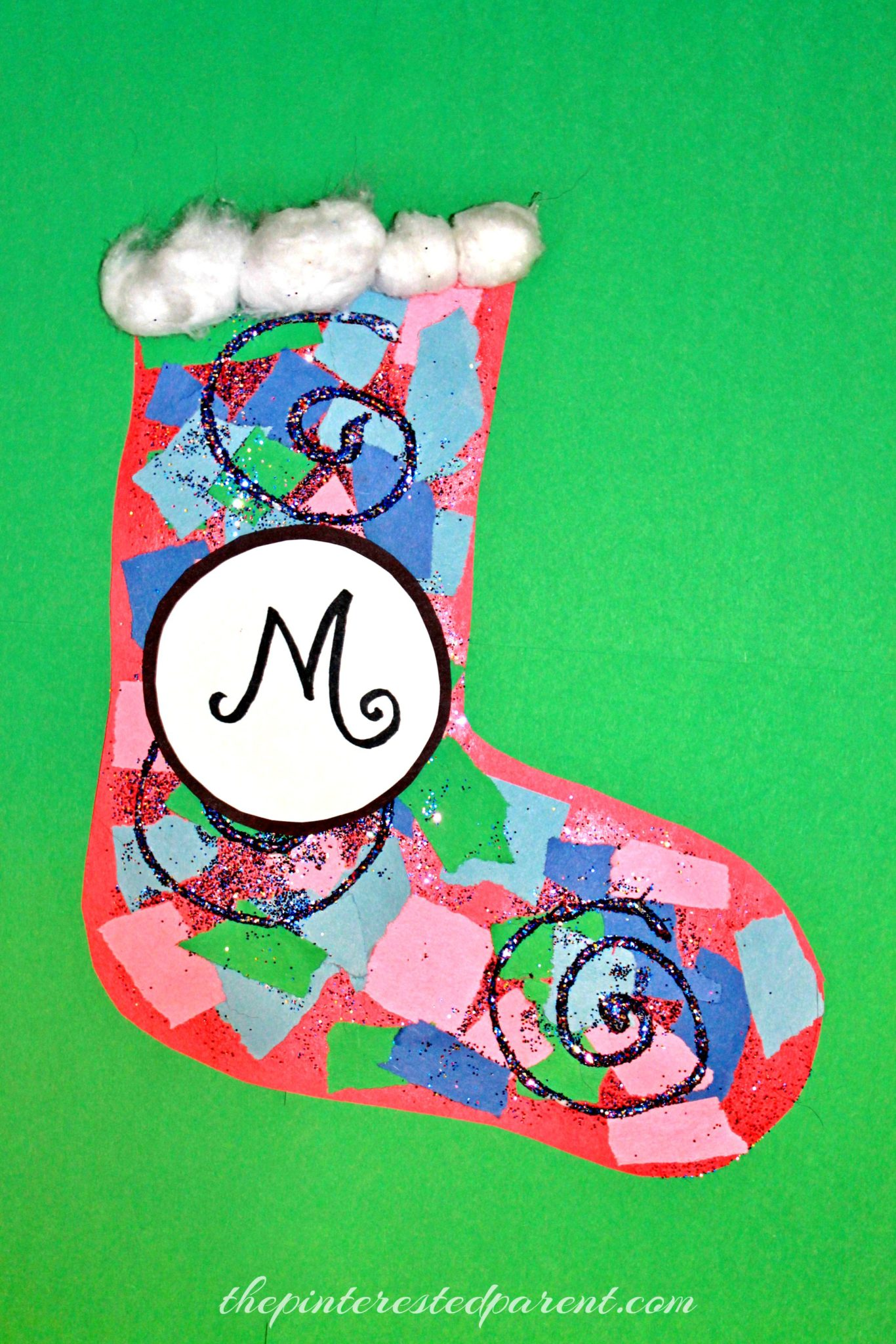 Torn paper christmas stockings the pinterested parent for Stocking crafts for toddlers