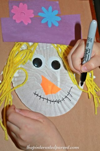 Cupcake Liner Scarecrow Craft - fall autumn arts & crafts for kids . Halloween projects