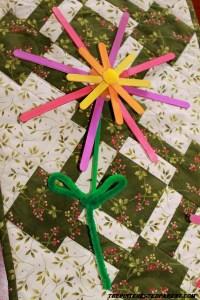 Add a pom pom or gemstone to the center of your flower.