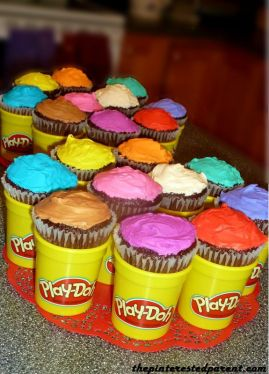 Multi-colored cupcakes fit perfectly inside of empty & clean Play-Doh containers. For a birthday party