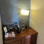 Mini bar with coffee maker.