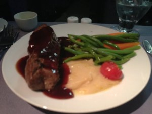 Tasty steak dinner in BusinessFirst