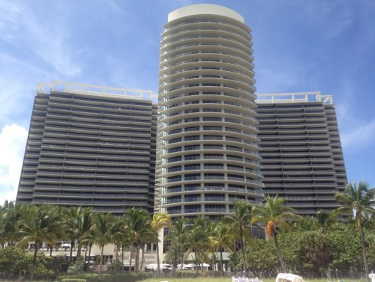 The exterior of the hotel, viewed from the beach.