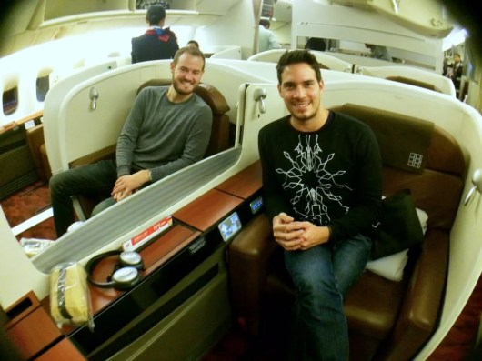 Me (left) and Julio onboard JAL's Bowing 700-300, in our adjoining first-class Sky Suites.