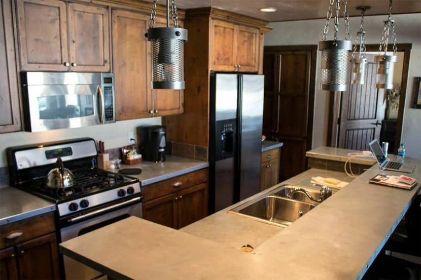 A cheery, open kitchen greets you as you enter the unit
