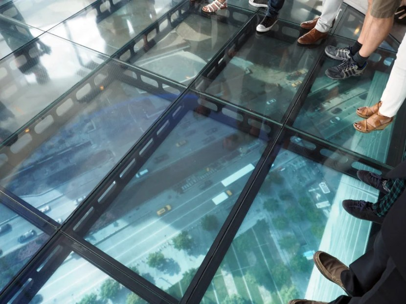 You can step out onto a realtime view of moving traffic 100 feet below (those are HDTVs under glass — there's no risk of falling here).