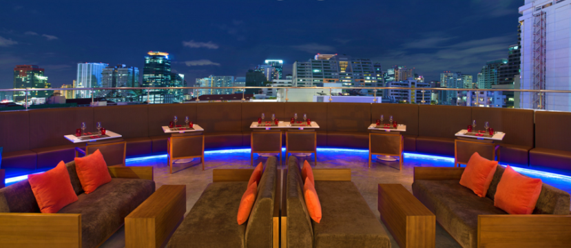 Crave Wine Bar & Restaurant at the Aloft Bangkok includes an outdoor terrace for al fresco dining.