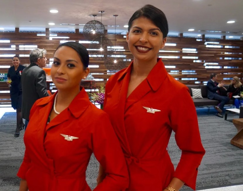 Also in Delta red at the lounge's launch: delightful and on-point Delta flight attendants.