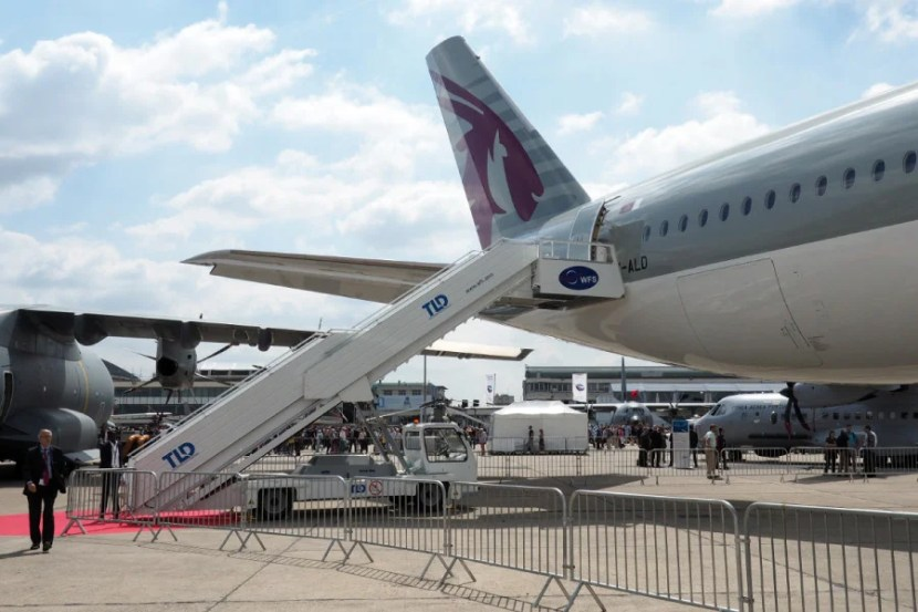 Guests enter through the front and leave through the rear door at the Paris Air Show.