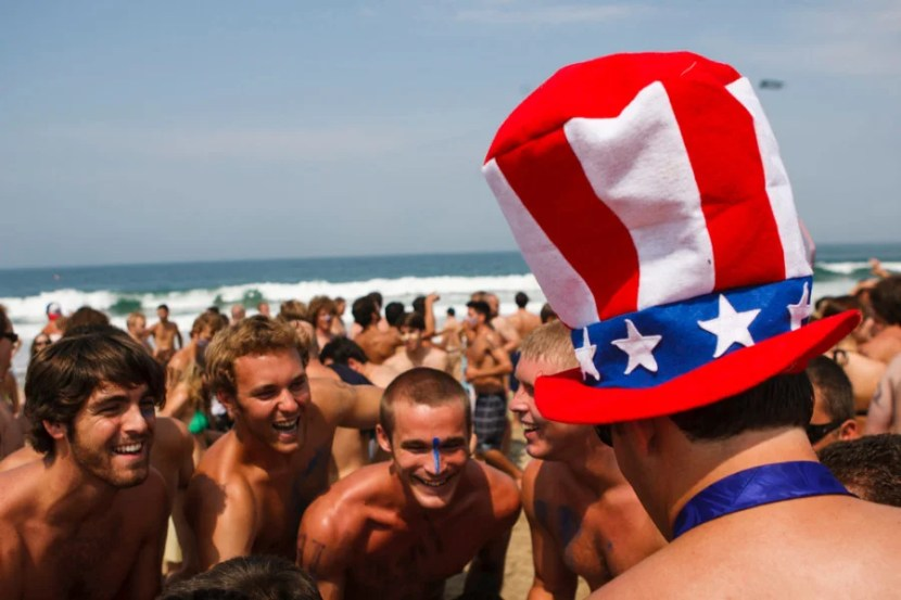 Competitors celebrate the 4th of July by participating in the annual Iron Man on Friday, July 4, 2008 in Hermosa Beach, Calif. Competitors haul themselves, flags, and beer into the air to celebrate Independence Day and show their patriotism as part of the Iron Man competition on July 4, 2009. In the Iron Man, a Hermosa Beach 4th of July tradition for 32 years, participants must run a mile, paddle board a mile, then chug a six-pack of beer, awards are given to those who do not puke Ð and those who puke the best. © 2015 Patrick T. Fallon