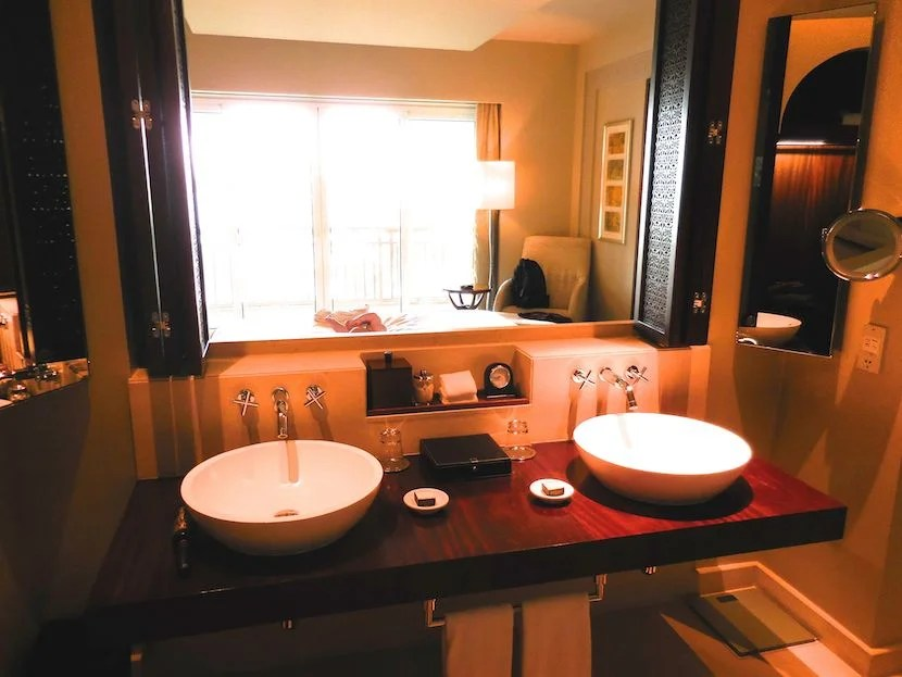The double sink vanity overlooks the bedroom and out onto the terrace.