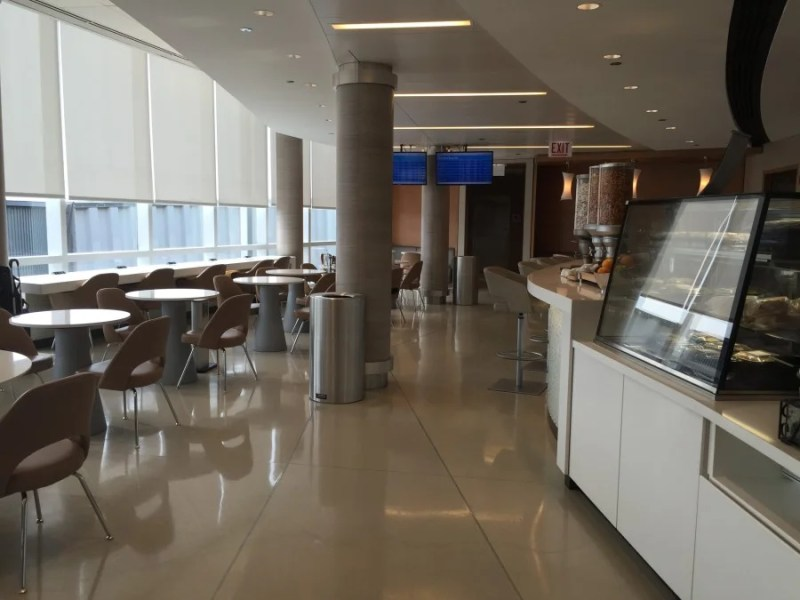 The dining area at concourse G's Admirals Club offers additional seating, including a few comfortable booths.