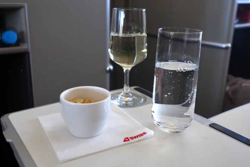 Champagne, nuts and water were served shortly after takeoff.