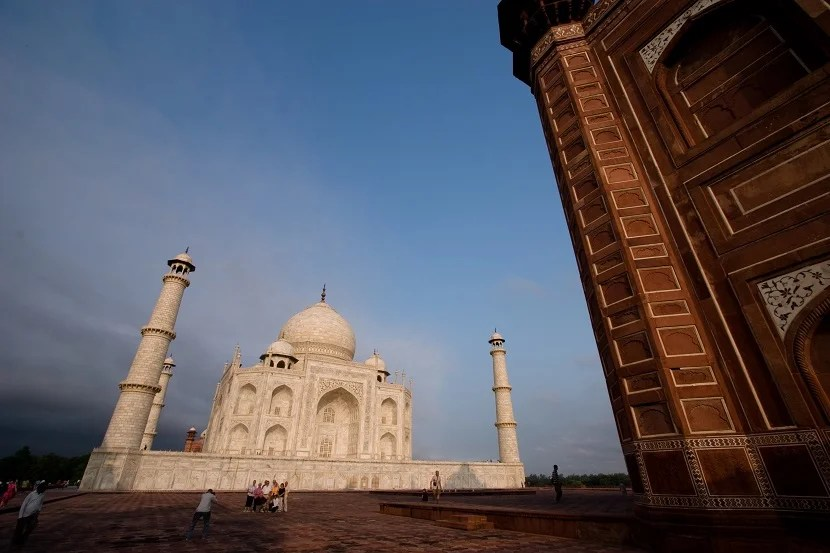 The Taj is designed to convey a sense of longing.  Photographing it in relation to the other buildings around it will help bring your photos to life.