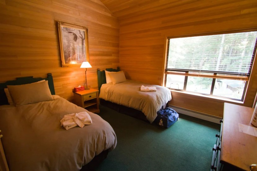 Rooms at the Outpost are small and cozy, and include en-suite bathrooms and terry robes (you'll need them for the outdoor hot tubs).