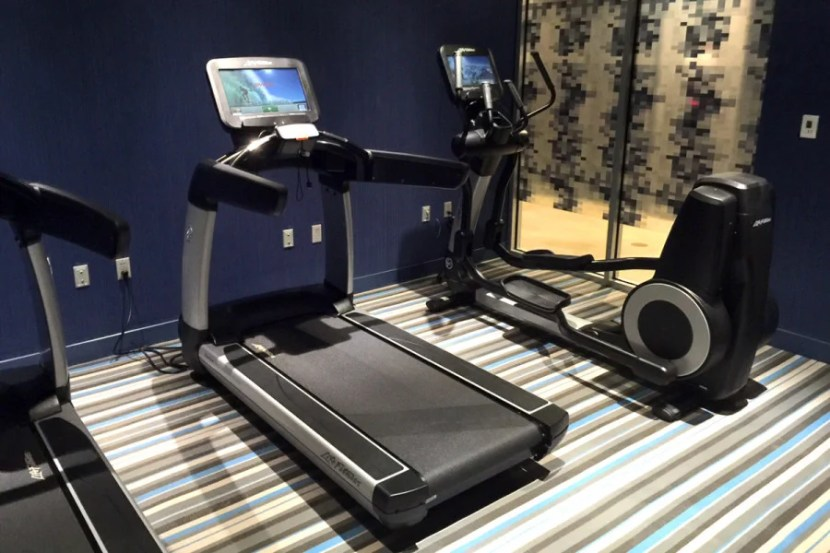 The gym is basic, with two treadmills and an elliptical machine.