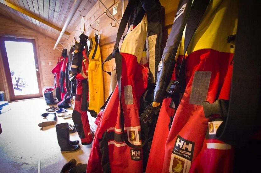 Custom-sized Helly Hanson rain gear — including boots, hoods and coveralls — are provided for all guests.
