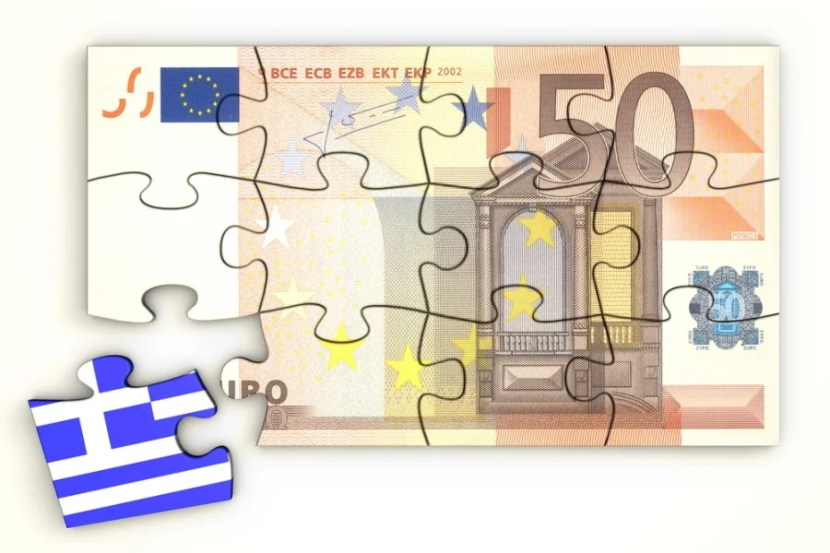 """Photo courtesy of <a href=""""http://www.shutterstock.com/pic-78778399/stock-photo--euro-note-from-top-as-a-puzzle-one-piece-separately-extra-piece-with-greece-greek-flag-on.html?src=-Up4m2audHFsyjcMgxLltw-1-16"""">Shutterstock</a>"""