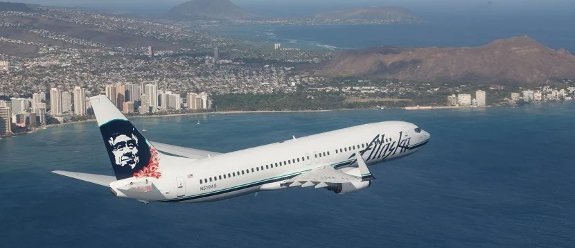 Alaska Airlines plane over Hawaii Oahu banner