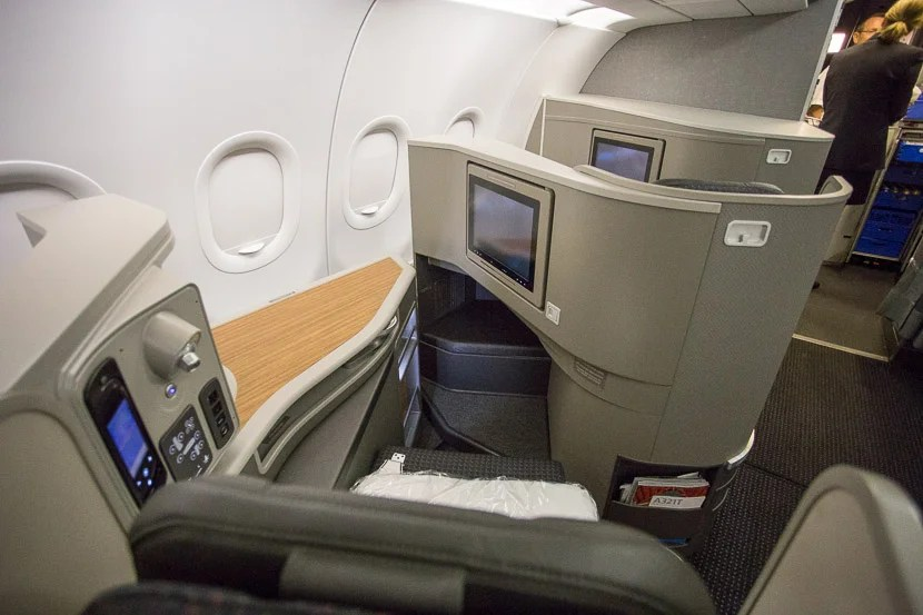 The seat features a nice space to keep drinks and other personal items, as well as a large personal entertainment screen.