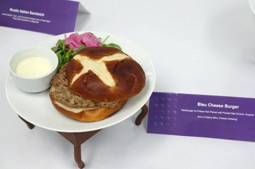Bleu cheese burger on a pretzel roll.