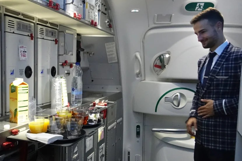 A flight attendant in the forward galley.