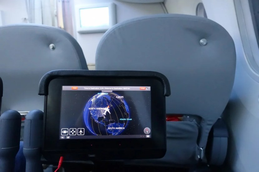 The IFE system pops out from between the seats.
