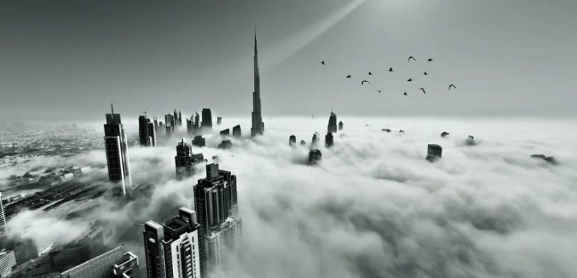 Dubai skyline over clouds featured shutterstock 166203821