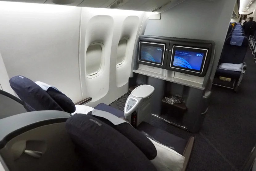 The last row of the 777-200 has rear-facing seats - say hi to the folks in economy!