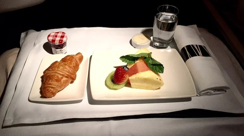 Breakfast started with fruits and bread.
