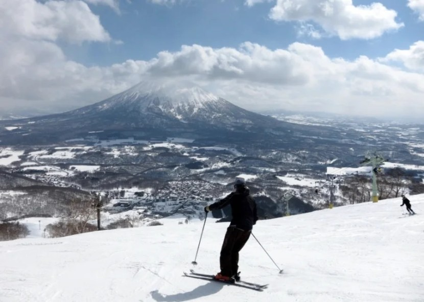 Visitors flock to Hokkaido's Niseko region to ski in the shadow of Mt. Yotei. Photo courtesy of Shutterstock.
