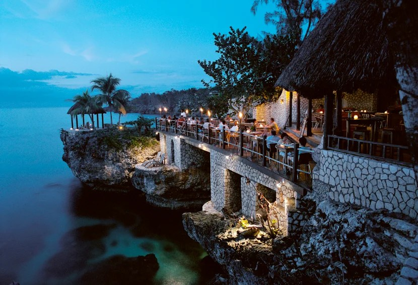Stay in Rockhouse's Afrian-inspired village carved into volcanic rock along Pristine Cove in Negril.