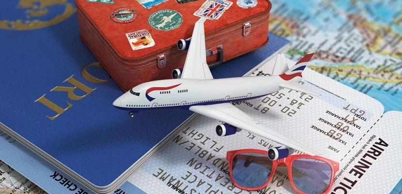 Passport ticket plane luggage featured shutterstock 290501264