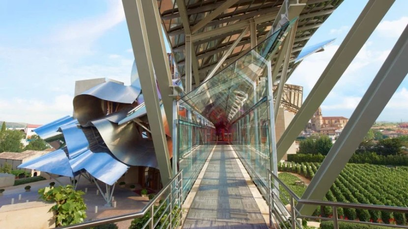 The glass, metal and wood footbridge.
