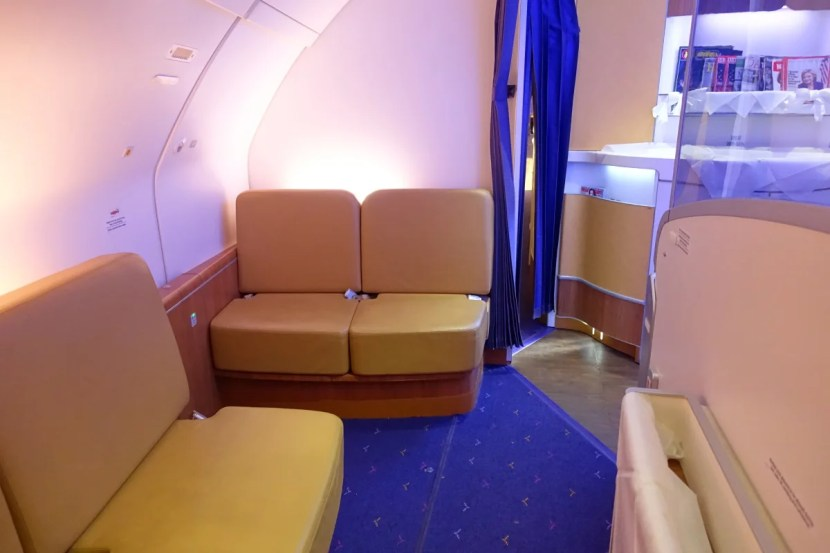There's a small first-class lounge at the front of the cabin.