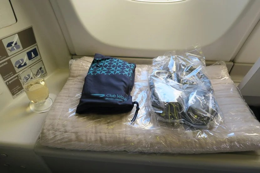 Once closed, the window-side locker served as a table for my welcome drink as well a resting place for my amenity kit, headphones and blanket.