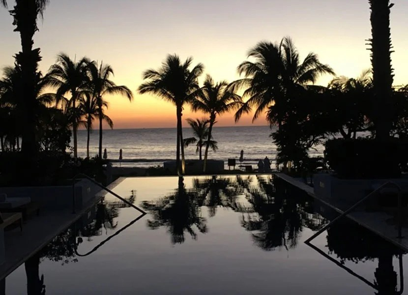 Enjoying a gorgeous view of the main infinity pool at sunset.