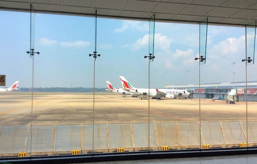 Checking out the planes on the tarmac at Colombo.