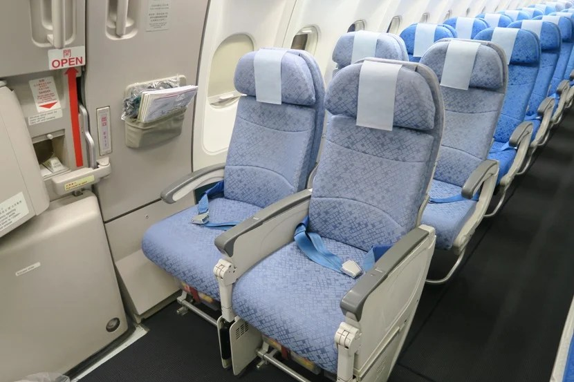 While you may be tempted by the exit row, be wary that this area was a crowded part of the plane at cruising altitude.
