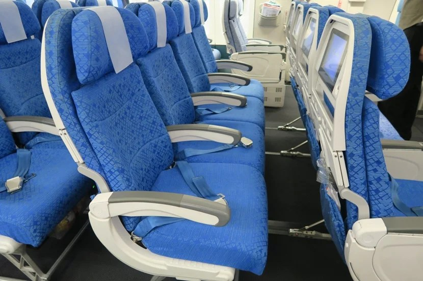 "If you happen to be on an empty flight, the four-seat middle rows could turn into a nice ""poor man's lay-flat seat."""