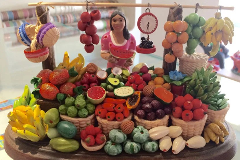 You'll find inexpensive, artisan-made souvenirs (like this $32 Colombian fruit seller) in several galleries and shops around Old Town.
